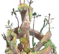 """Bruno Miguel, """"Morro do Polke"""" – Série Móveis paisagens, Isopor, espuma de poliuretano, papel marche, resina acrílica, porcelana fria, arame, partes de móveis, 162 x 95 cm, 2011."""