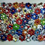 Pacthwor, Bolas de futebol abertas e recosturadas, 122 x 175 cm, 2011.