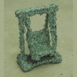 Balanço Financeiro, Cédulas de Real picadas coladas sobre brinquedo, 25 x 15 x 10 cm, 2004, Edição feita com notas de 100 Reais Tiragem de 20 exemplares.