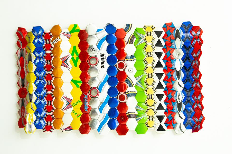 Campos, Bolas de Futebol abertas e recosturadas, 145 x 90 cm, 2012